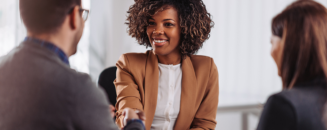 Woman shaking hands after successful interview