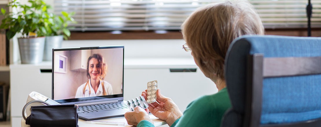 Elderly woman with virtual doctor